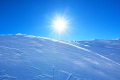 Sun over mountain snow cap Stock Photo