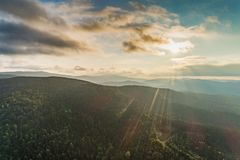 Sun over mountains aerial view stock photo