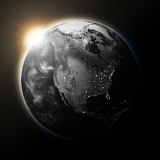 Sun over North America on dark planet Earth Royalty Free Stock Photos