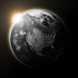 Sun over North America on dark planet Earth Royalty Free Stock Photos