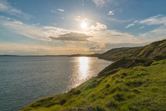 Osmington Bay, Jurassic Coast, Dorset, UK. Sun over Osmington Bay, near Weymouth, Osmington Bay, Jurassic Coast, Dorset, UK Royalty Free Stock Images