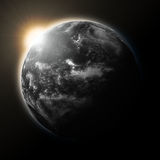Sun over Pacific Ocean on dark planet Earth Royalty Free Stock Photography