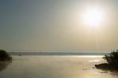 Sun over Panasoffkee Lake, USA. Tranquil scene of sun over Panasoffkee Lake, Florida, USA Stock Image