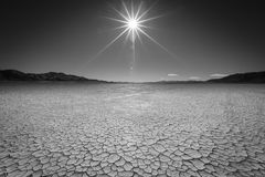 Sun over the Playa. The Black Rock Desert in Northern Nevada is one of the most desolate places I have ever been - Miles of flat cracked playa in the summer and royalty free stock images