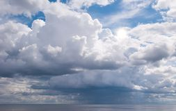 Sun over a rain cloud Royalty Free Stock Photography