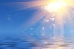 Sun over sea. With sun rays spreading Stock Photos