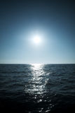 Sun over the sea horizon Stock Photo