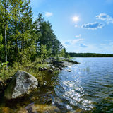 Sun over the shore of Ladoga lake Royalty Free Stock Photo