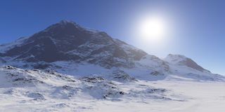 Sun over the snowcapped mountains. Royalty Free Stock Image
