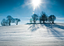 Sun over snowy Hill Stock Image