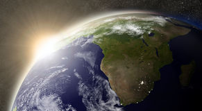 Sun over South Africa. Sunset over South Africa region on planet Earth viewed from space with Sun and stars in the background. Elements of this image furnished Royalty Free Stock Photography