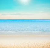 Sun over tropical beach Royalty Free Stock Images