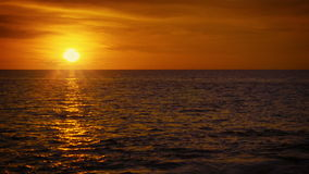 Sun over tropical ocean. Beautiful orange sunset