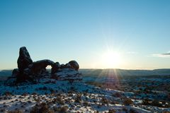 Sun over Turret Arch in Arches National Park Stock Images