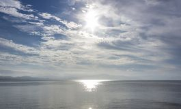 Sun over the water Stock Images