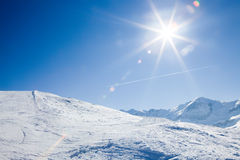Sun over winter mountains Stock Image