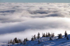 Sun over winter mountains, covered with snow. Royalty Free Stock Photos