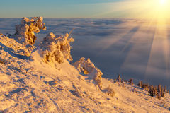 Sun over winter mountains, covered with snow. Stock Image