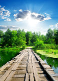Sun over wooden bridge Stock Images