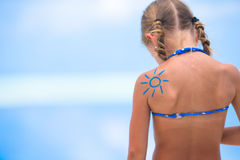 Sun painted by sun cream on kid shoulder Royalty Free Stock Photography