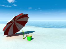 Sun parasol, bucket and spade on a beach. Stock Photography