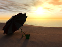 Sun parasol, bucket and spade on a beach. Stock Photos