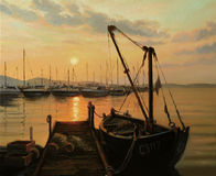 Sun Path. An oil painting on canvas of a romantic warm golden ocean sunset over the yacht harbor, with tranquil water surface, sun path and an old fishing boat Stock Photography