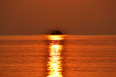 Sun path ship horizon Stock Images