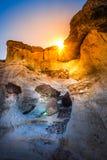 Sun peeking from behind the Wahweap Hoodoos near Kanab Stock Image