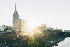 Sun Peeking in Between Buildings during Day Time Stock Photography