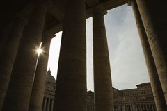 Sun peeking through doric columns. Stock Image