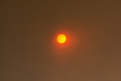 Sun peeking through smoke clouds from wildfire Royalty Free Stock Images