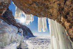 Sun peered into the ice grotto Olkhon Island on Lake Baikal Stock Image