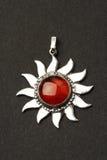 Sun pendant. Silver sun pendant with beautiful cornelian gemstone stock photography