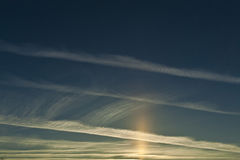 Sun pillar and contrails Royalty Free Stock Image