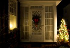 Sun Porch at Christmas. Night view of a side sun porch to a lovely Victorian mansion, decorated for the Christmas holidays in Cape May, New Jersey Stock Photography