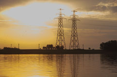 Sun and power pylons Royalty Free Stock Image