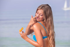 Sun protecion woman with suntan lotion Stock Images