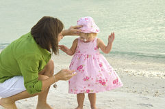Sun protection. A mother putting sunscreen on her daughter at the beach Royalty Free Stock Photography