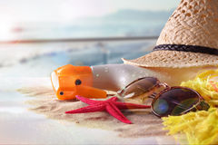 Sun protection articles on table in terrace overlooking beach. Sun protection articles with starfish on sand in glass table in terrace overlooking beach and sun Royalty Free Stock Photos