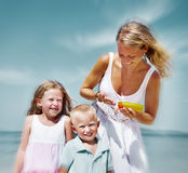 Sun protection on the Beach Mother Son Daughter Concept Stock Image