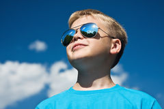 Sun Protection in the boy with glasses. Looks to the sky Royalty Free Stock Images