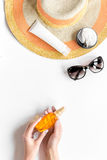 Sun protection composition with glasses and cream on white background top view Royalty Free Stock Photo