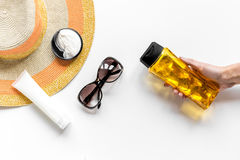 Sun protection composition with glasses and cream on white background top view Royalty Free Stock Photography