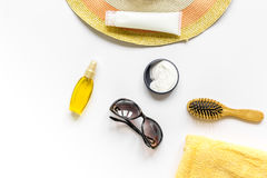 Sun protection composition with glasses and cream on white background top view mockup Royalty Free Stock Photo