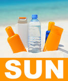 sun protection cream on beach background Stock Photo