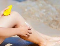 Sun protection cream on the leg Stock Photography