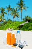 Sun protection cream on palm beach background Royalty Free Stock Photo