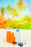 Sun protection cream on palm beach background. Tropical lanscape Royalty Free Stock Photography