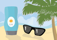 Sun protection cream and sunglasses on a beach Royalty Free Stock Photos